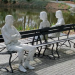 Seated figures on bench in NOMA Sculpture Garden