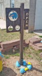 Zuni Artwalk sign, specializing in stone carving